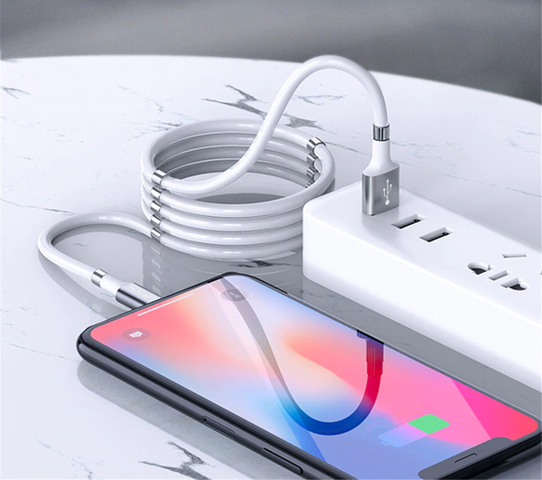 FlashWire coiled usb a to lightning charger connecting to phone on countertop
