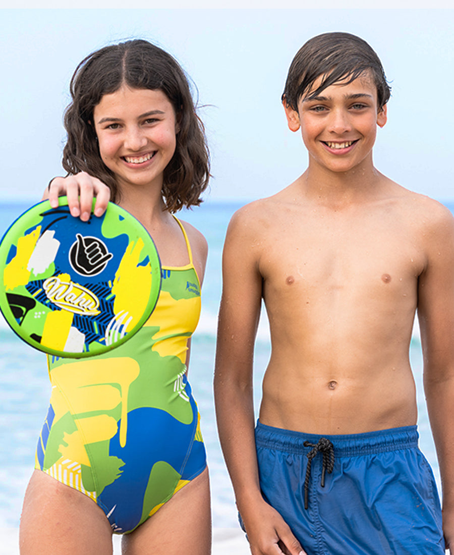 Girl and Boy on beach with Girl holding out a Wahu Frisc Frisbee