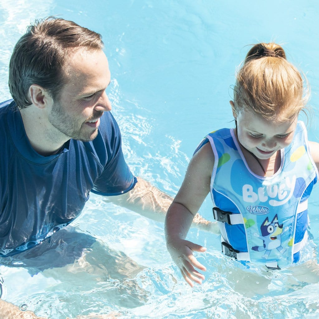 Father and Daughter in pool with child wearing Wahu x Bluey Swim Vest Child Medium 25-30kg