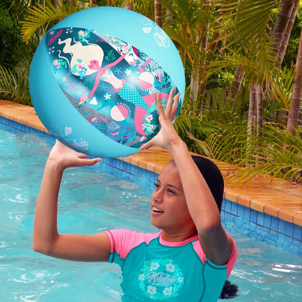 Child in pool playing with the Wahu Mermaid Beach Ball