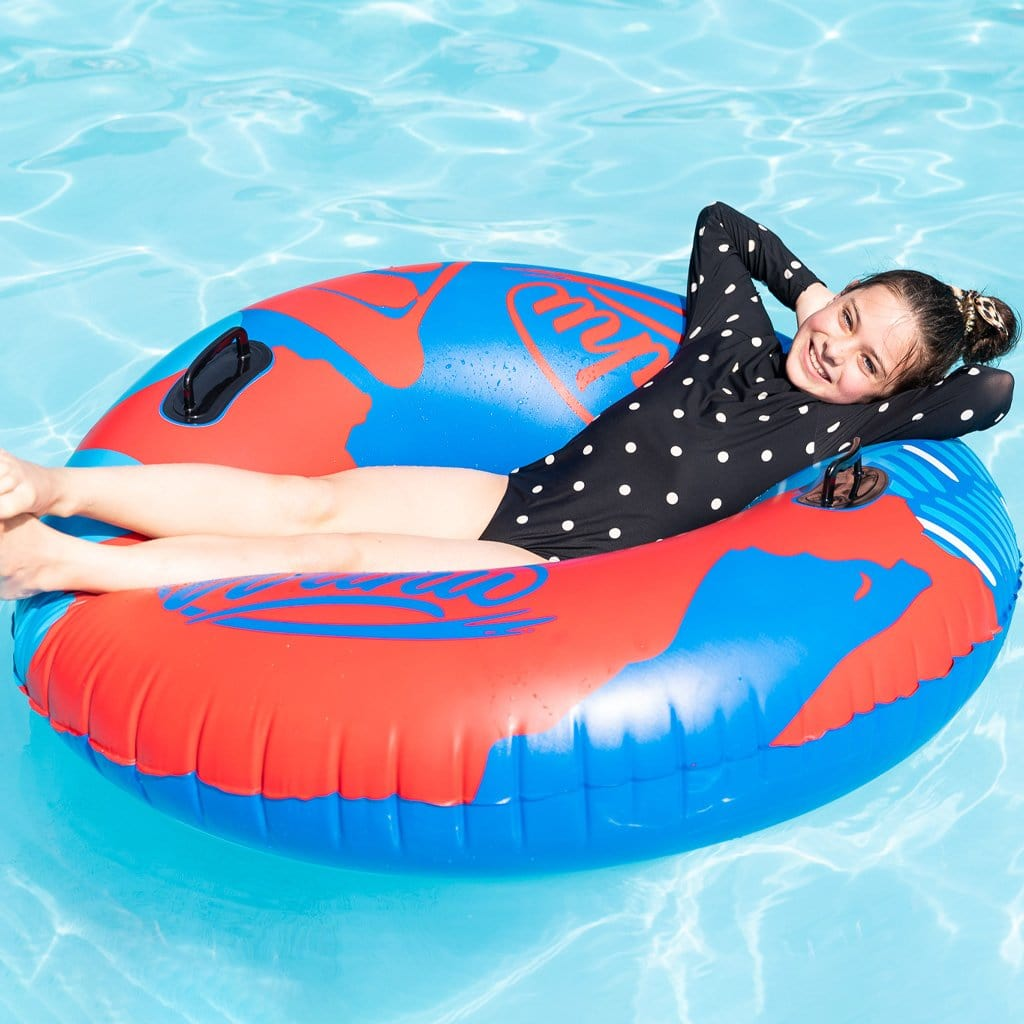 Child in pool relaxing on the Wahu Big O