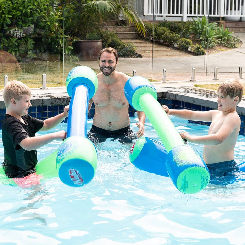 Family in pool playing with the Wahu Tube Wars