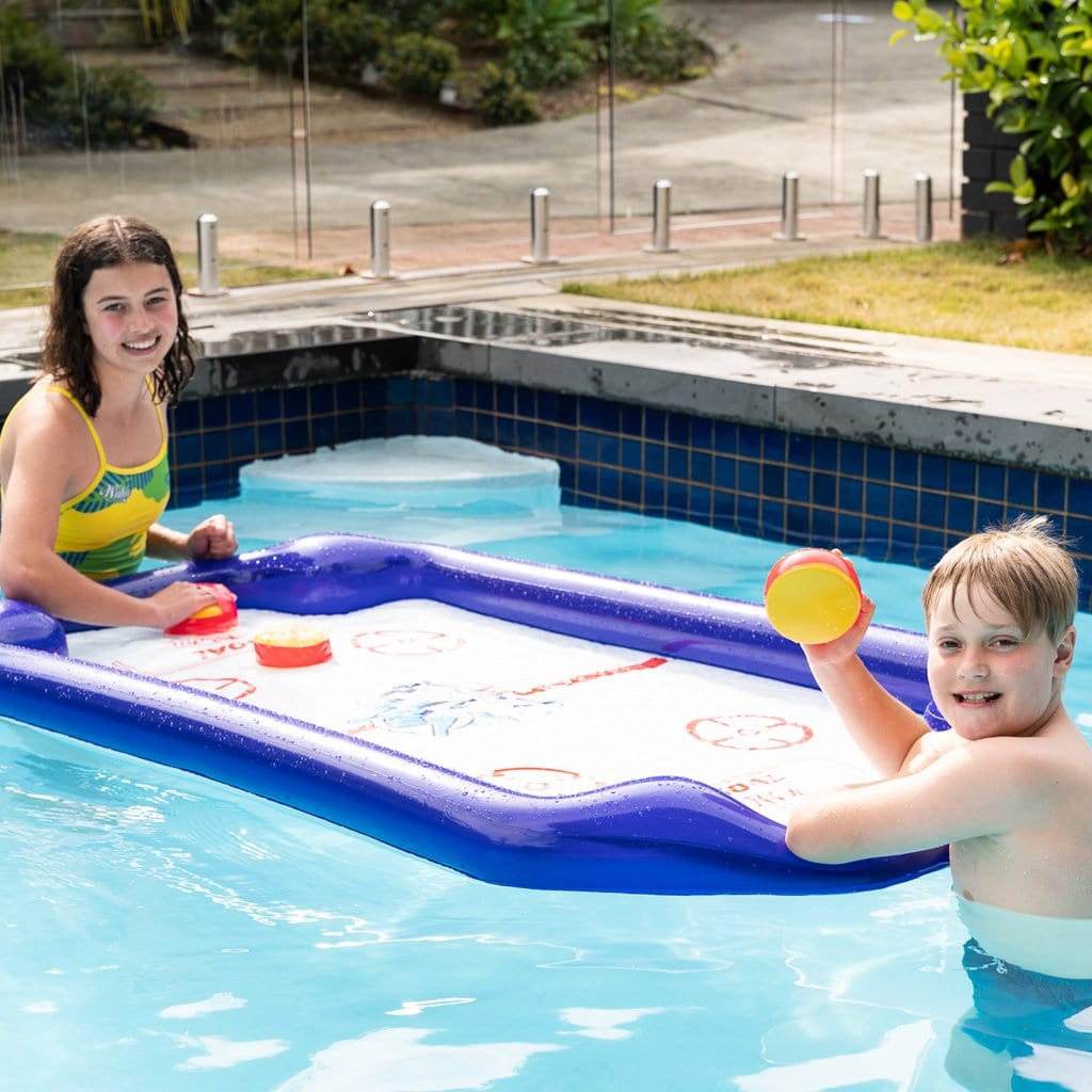 Children in the pool playing with the Wahu Aqua Hockey