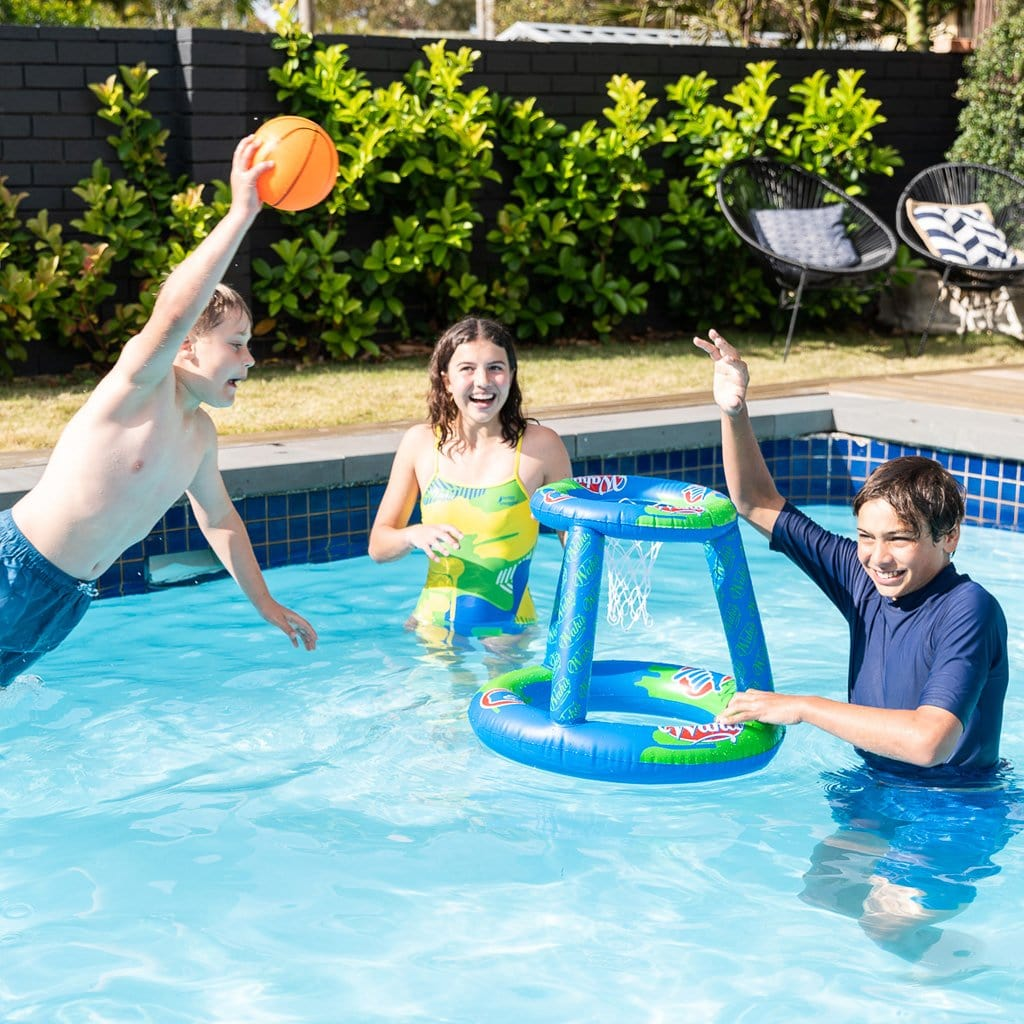 Children in pool playing with he Wahu Pool Baksetball