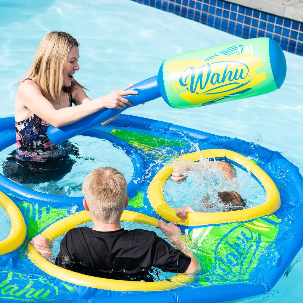 Family in pool playing with the Wahu Pool Bopper