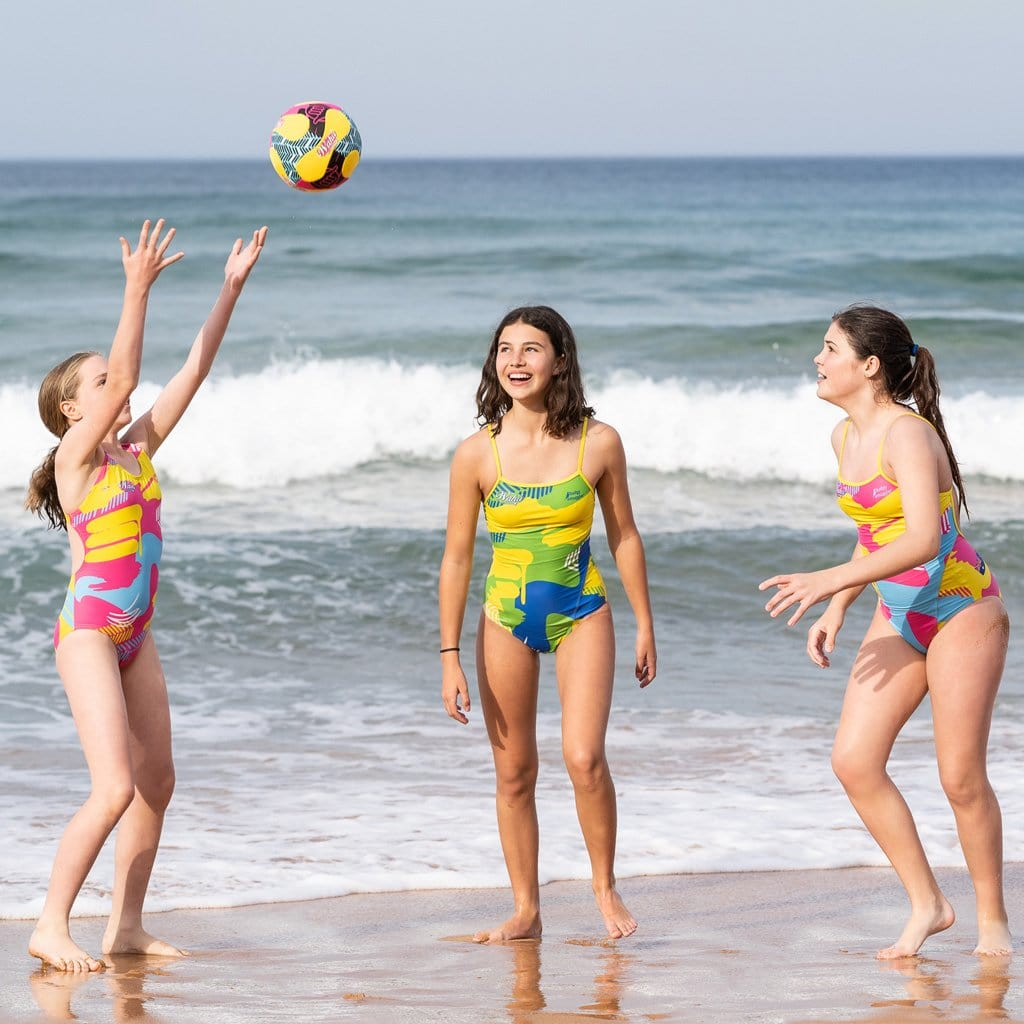 Children at the beach playing with the Wahu Soccer Ball