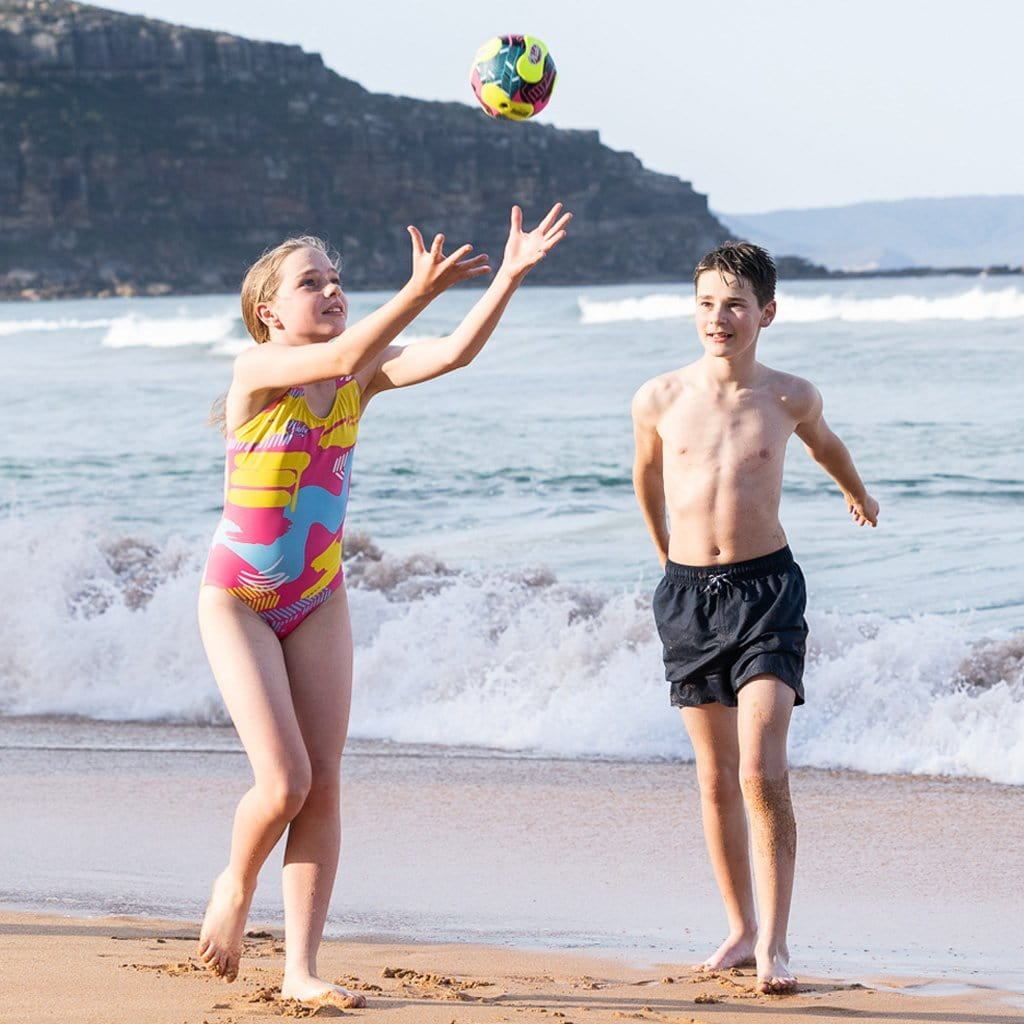 Children at beach playing with the Wahu Mini Soccer