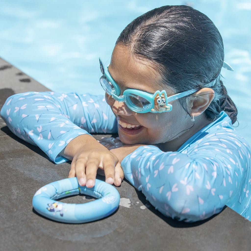 Child in pool wearing the Wahu x Bluey Goggles