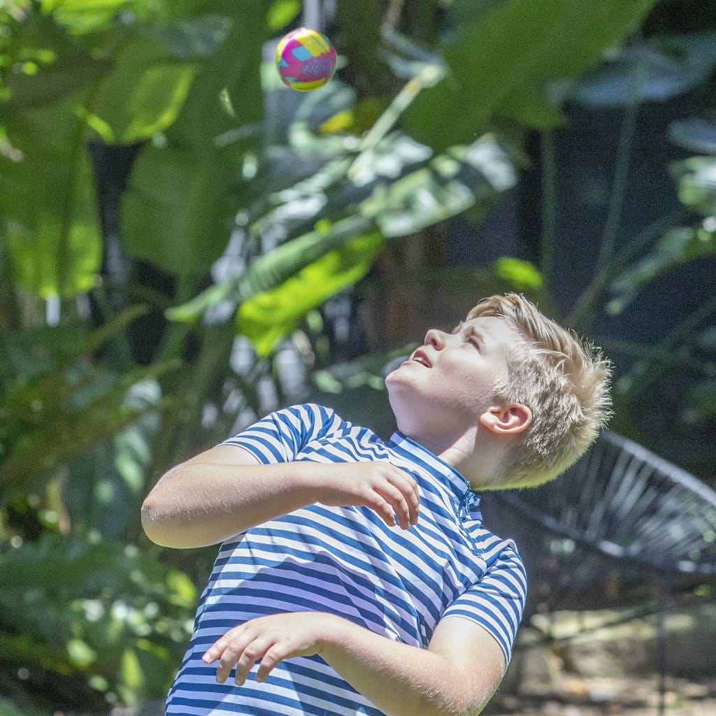 Child in backard palying with the Wahu High Bounce Ball 7cm