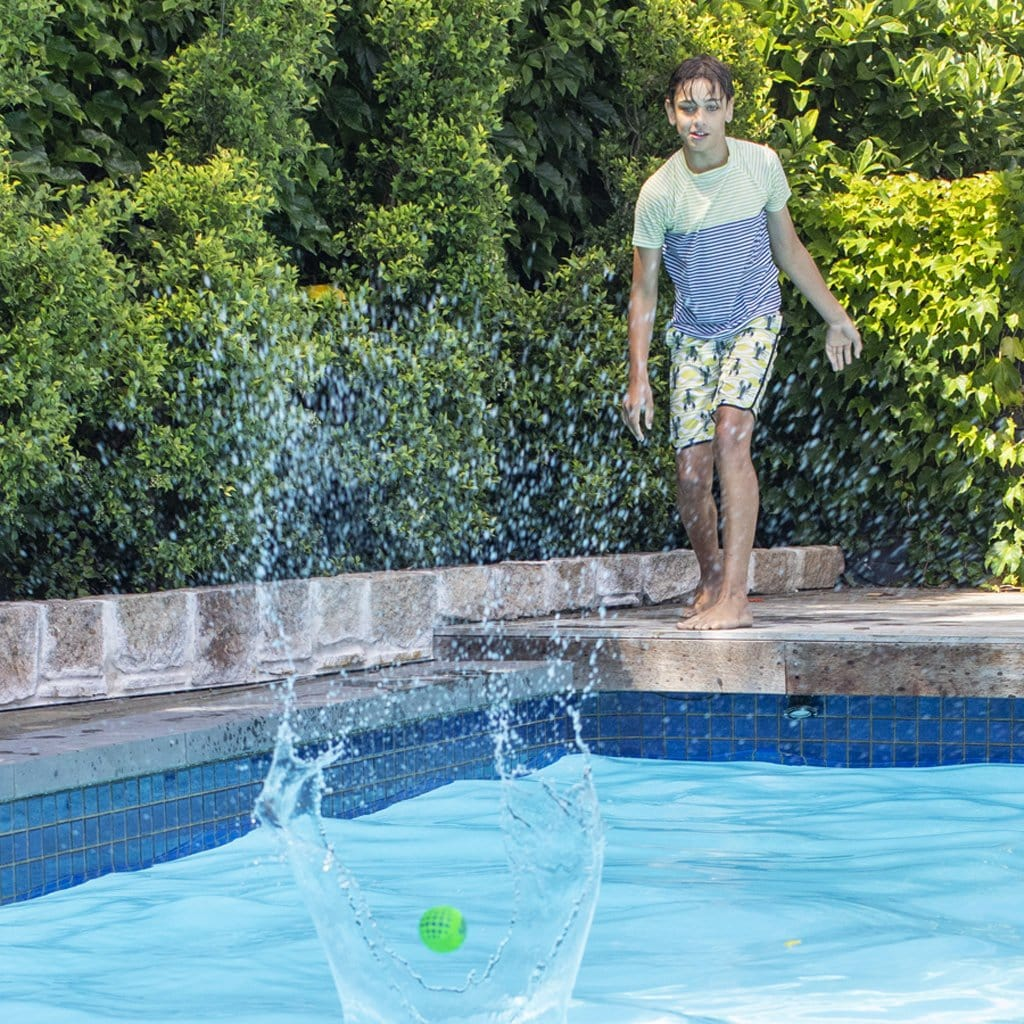 Child playing with the Wahu Super Grip Skimball 6cm at pool