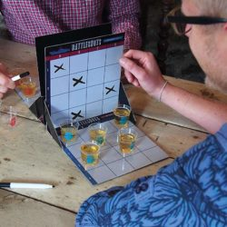 battle shots drinking game setup for two people at the table.