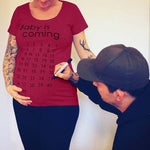 Load image into Gallery viewer, Baby is Coming Maternity Shirt with Calendar Days to Track Your Progress