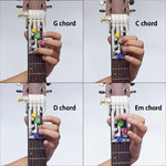 Load image into Gallery viewer, playing different chords with colorful guitar helper buddy.