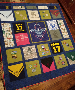 This boy scout quilt incorporates t-shirts, a specialized panel, kerchiefs, and patches.
