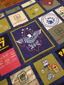 A special panel takes center stage, and patches are sewn individually to quilt blocks.