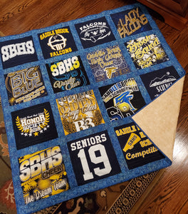 Blue and gold school colors highlight this cheerleading-themed quilt.