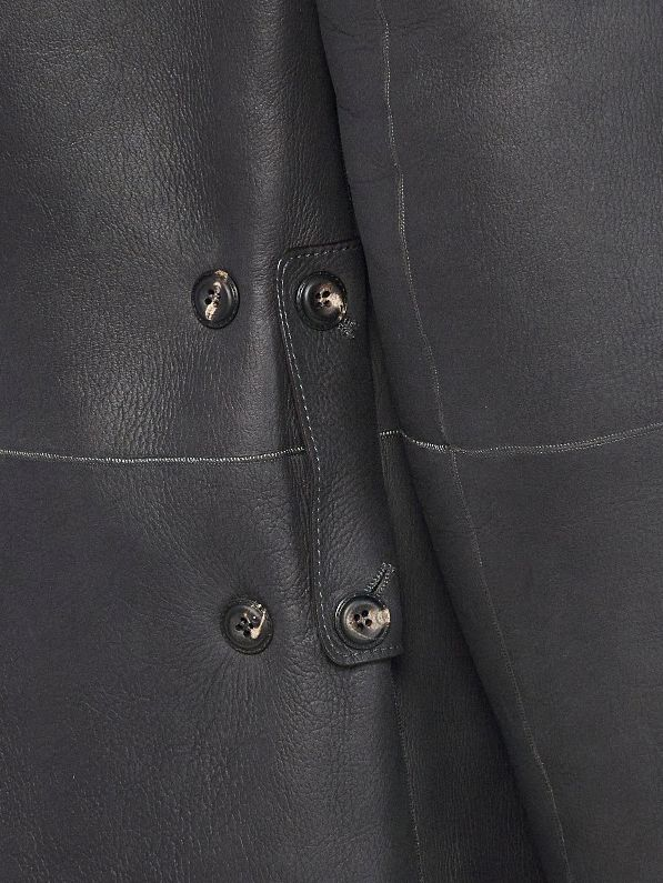 Reversed side latch attaches 2-sets of buttons tightening the waist and creating elongated pleats