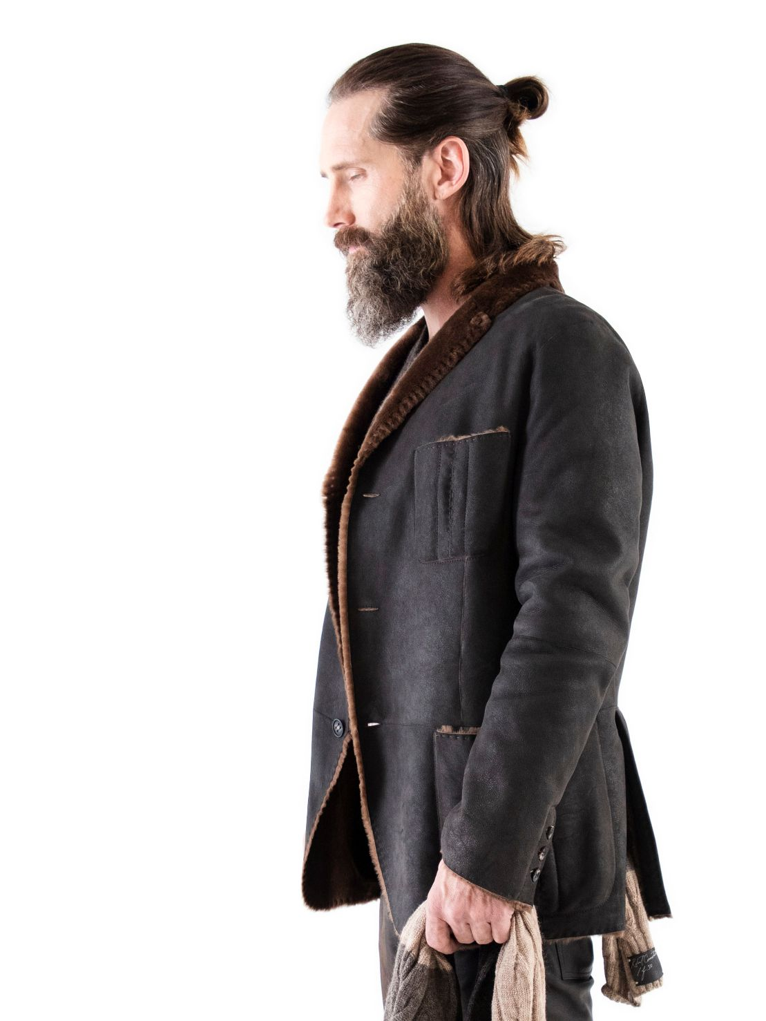 Silhouette of Spanish Lancon featherweight shearling with horn buttons, raw cut seams and patch pockets