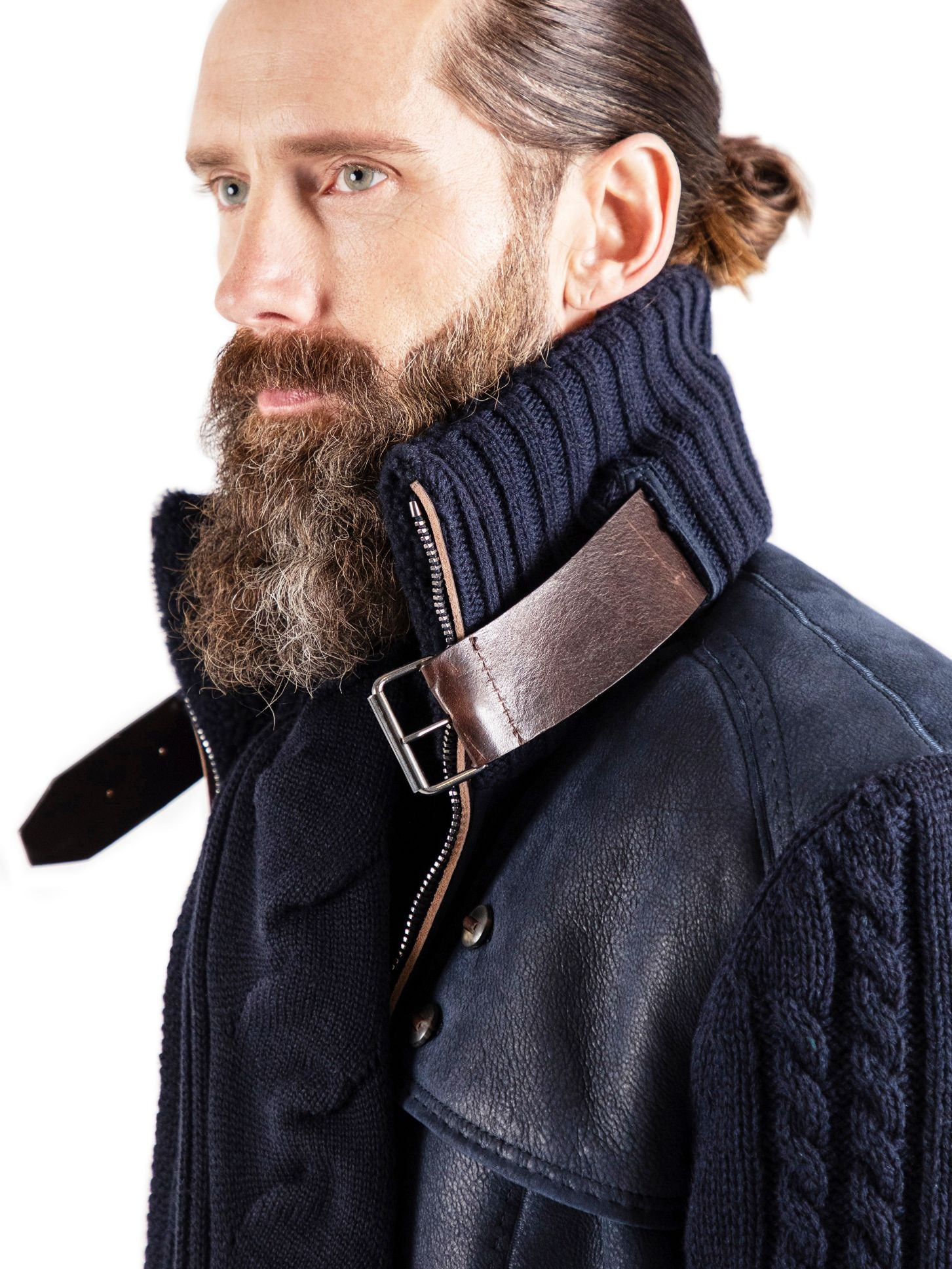 Italian calf belting leather exits the channel of a luxurious cashmere neck mirrored by a thinly skived version, which also frames the entire zipper length