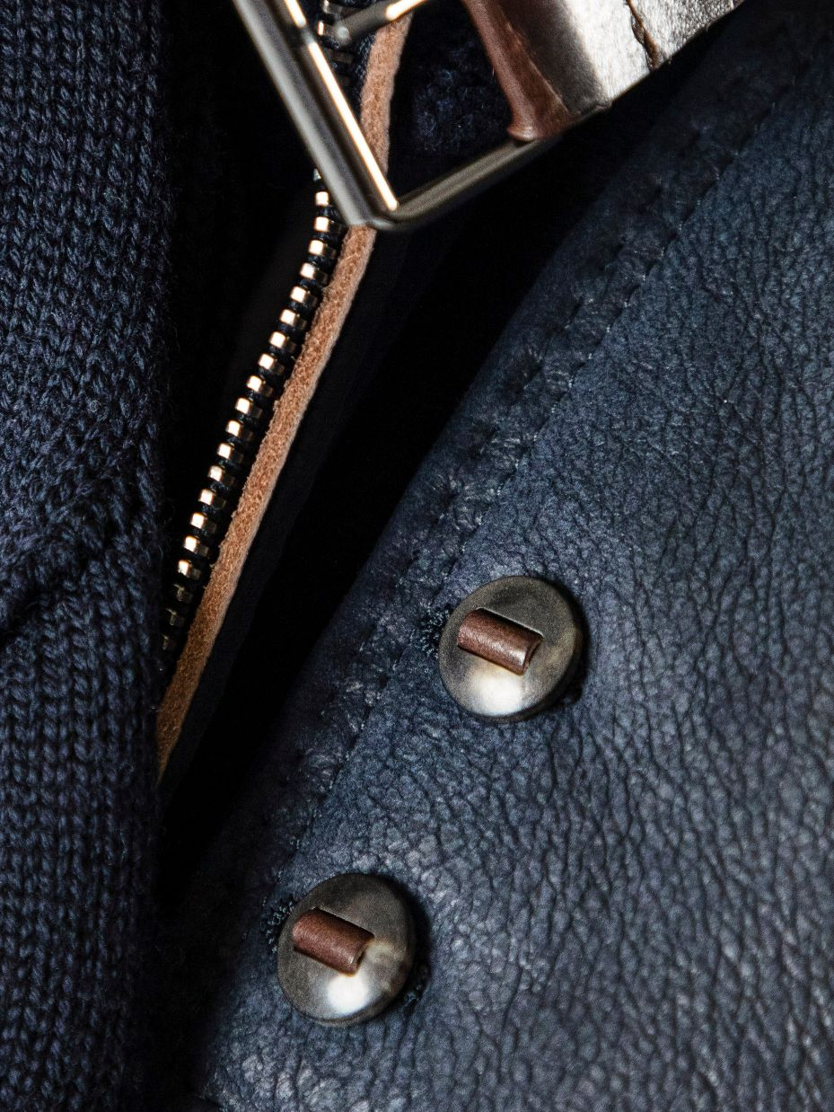 Skived Italian calfskin anchors ribbon buttons made from horn