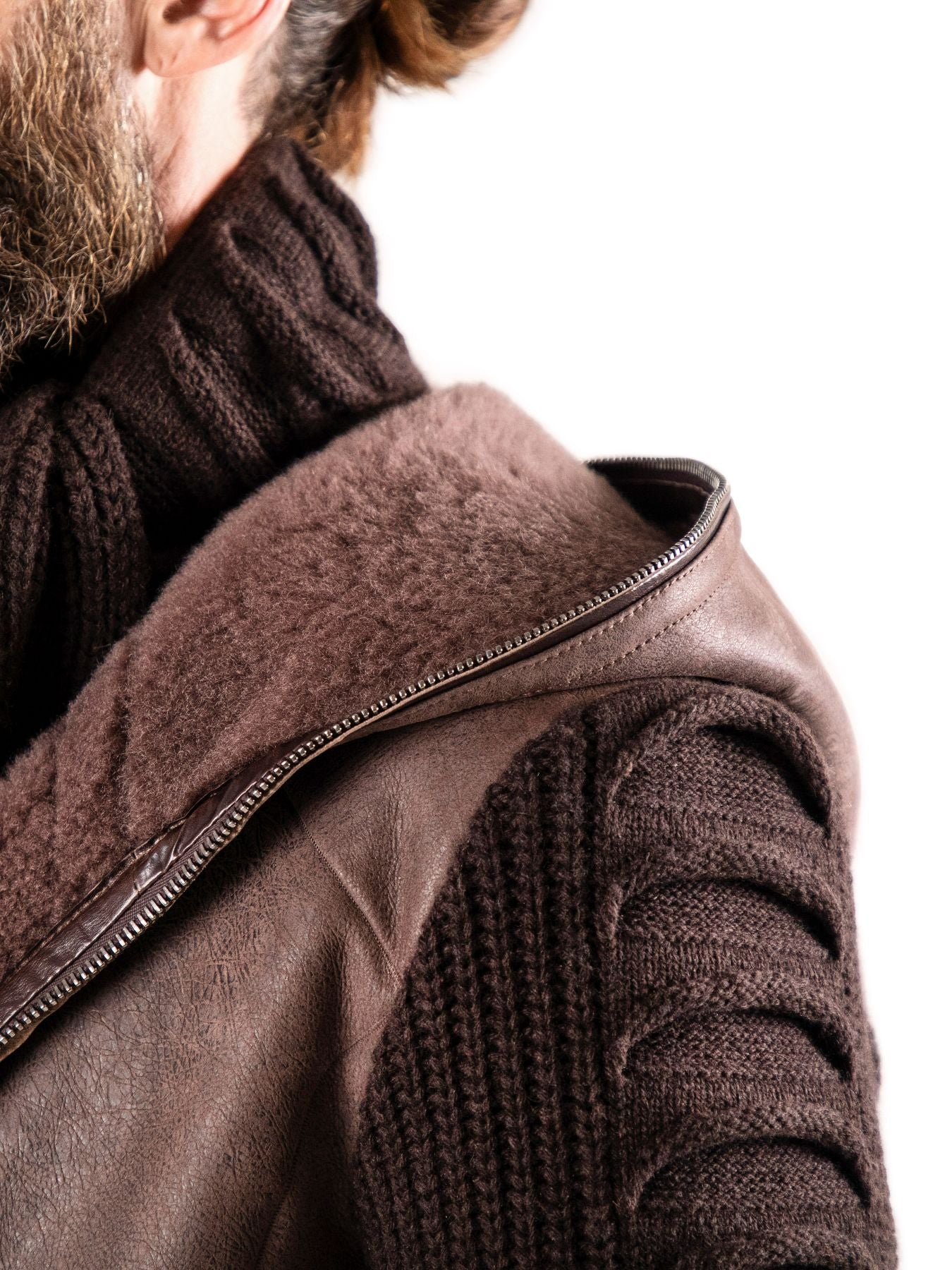 In perfect harmony, mélange cashmere sleeves emanate from an Italian shearling of impossible softness