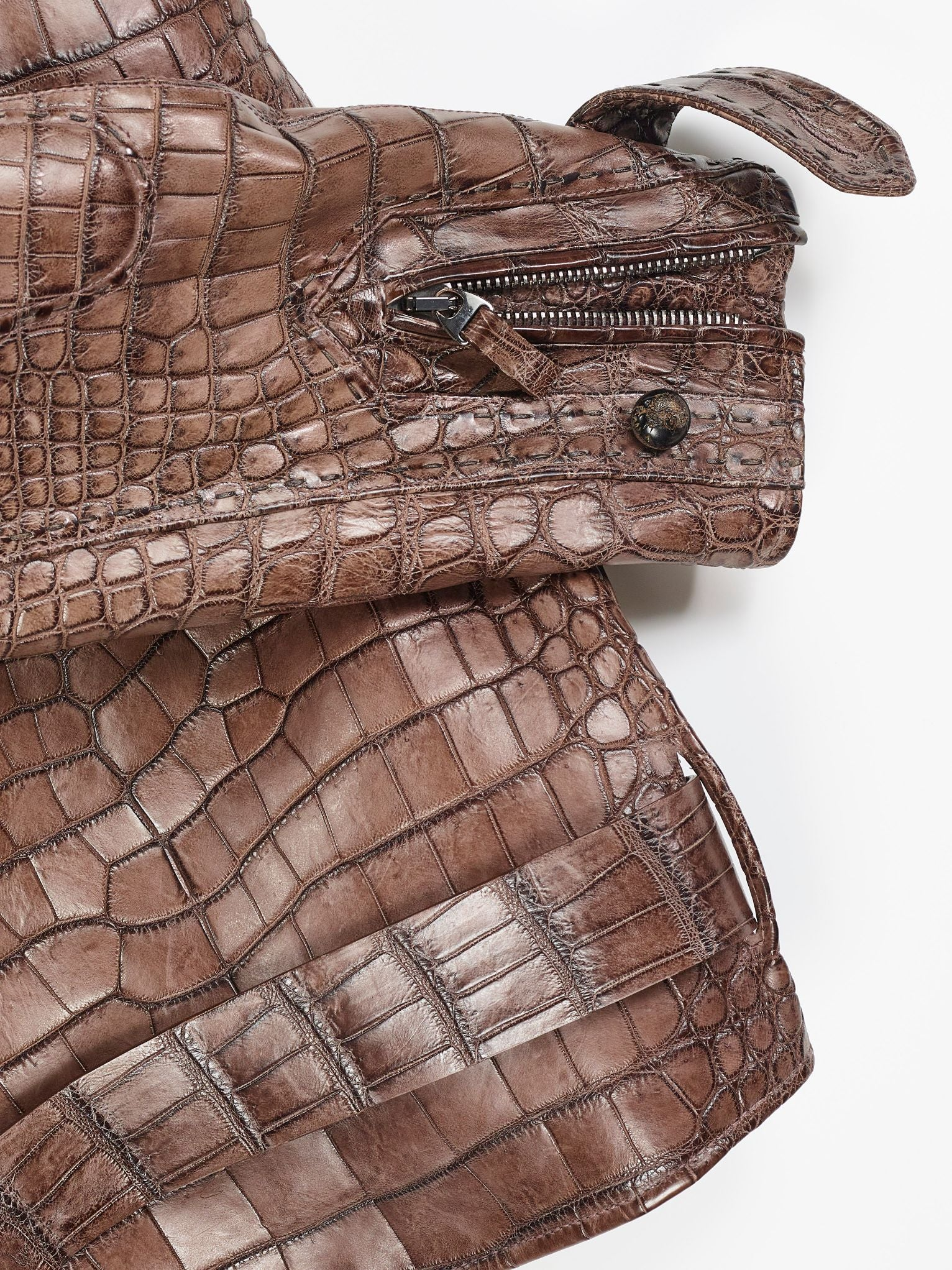 Each panel of the jacket is meticulously joined and often hand-stitched to perfectly match skin patterns
