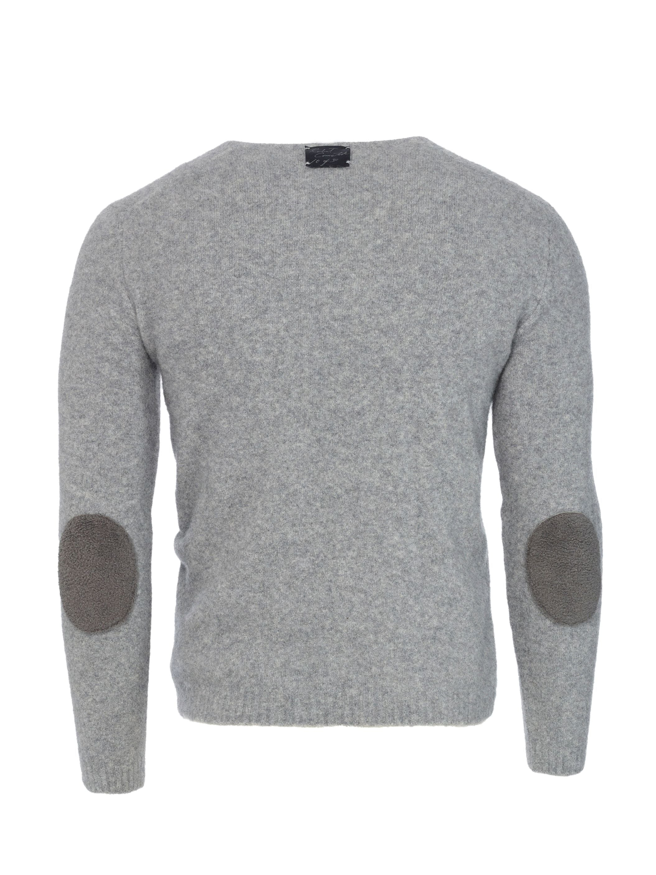 Cashmere fleece is accented by Baby Astrakhan lamb elbow patches