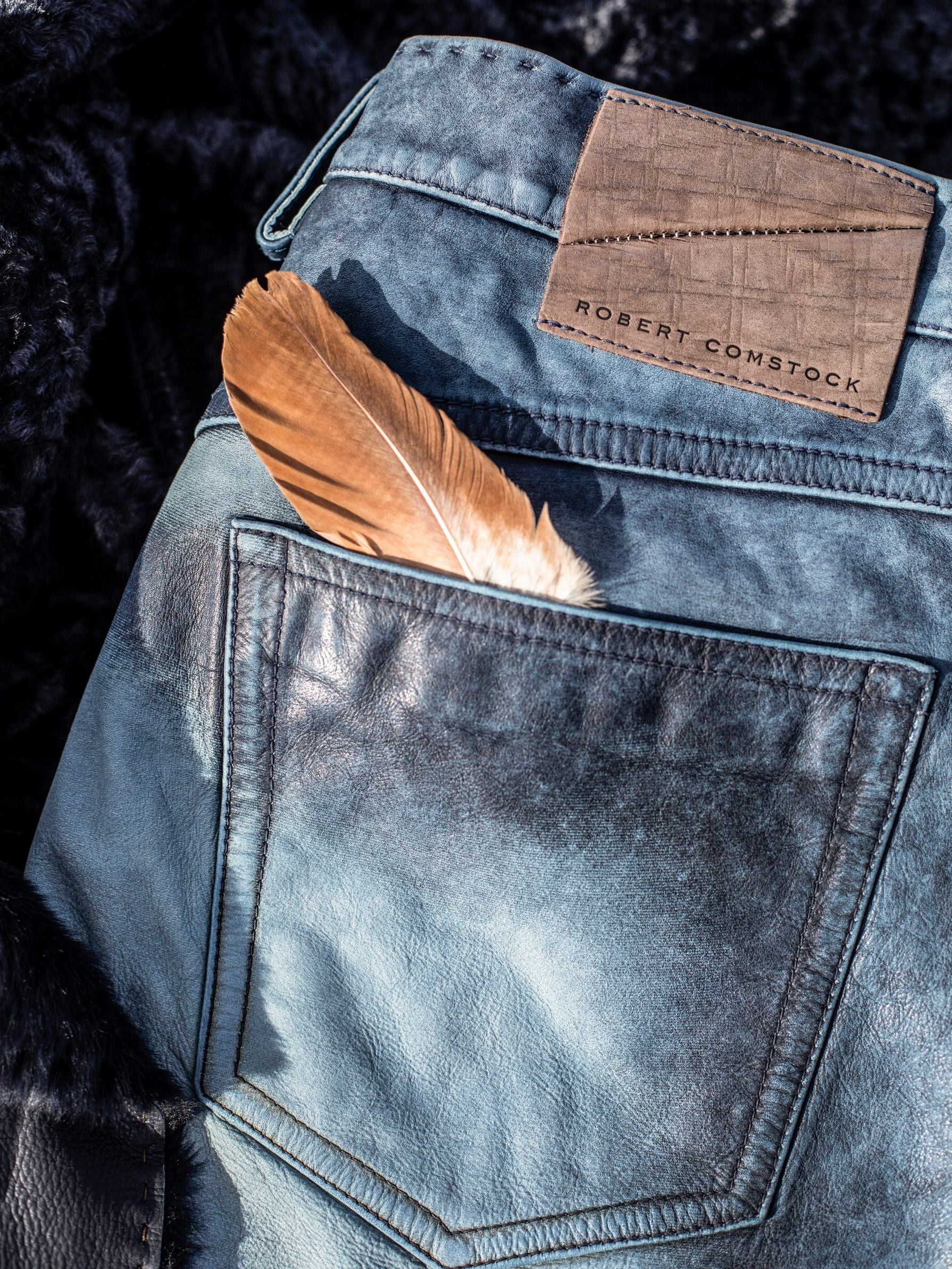 Pick stitched waist with high & low distressing throughout jean