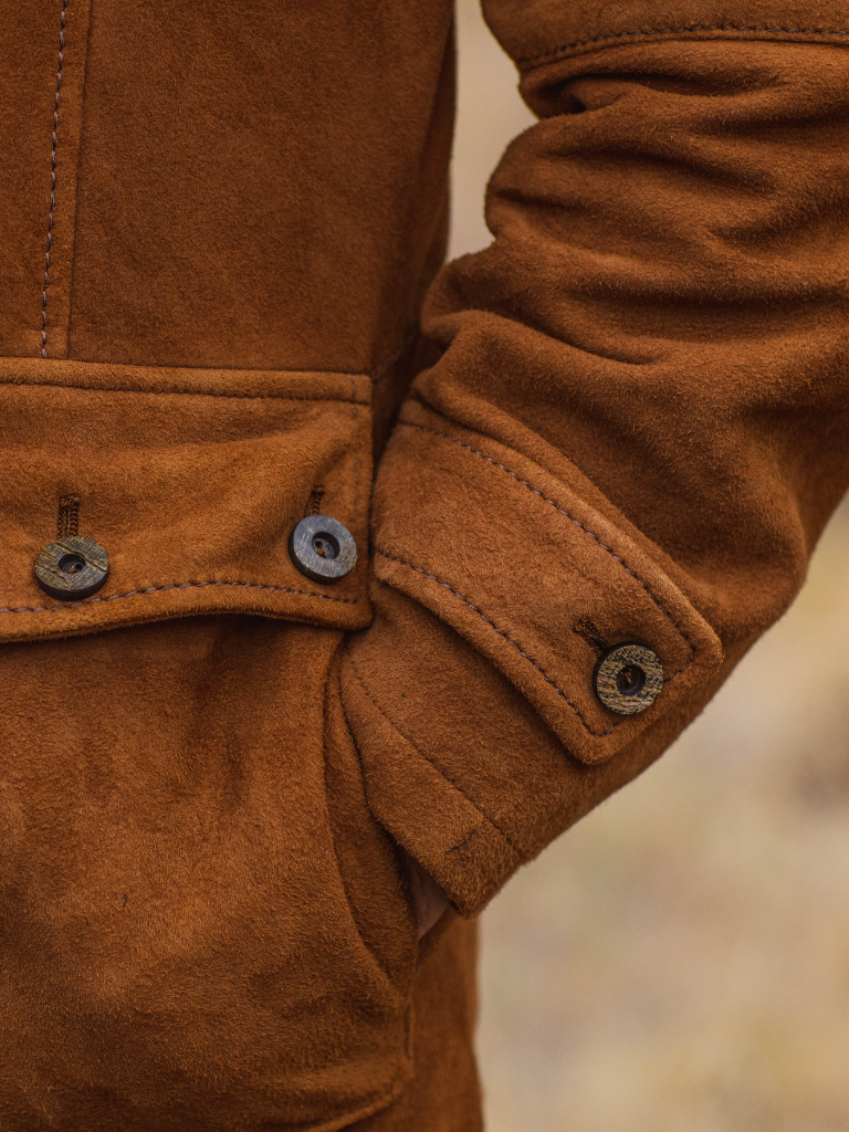 Supple and rich lamb suede provides unimaginable comfort and ease for dual access front pockets