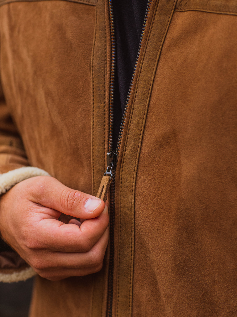 Tone-on-tone double sided steerhide effortlessly glides the YKK antique zipper on its trajectory