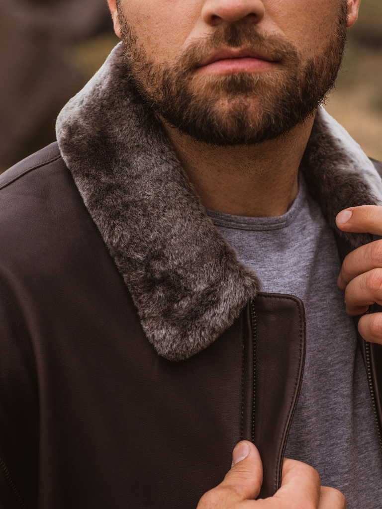 Silky soft lamb-fleece collar and train-track stitching on besom pockets with an elasticized nappa waistband create a one-of-a-kind heirloom.