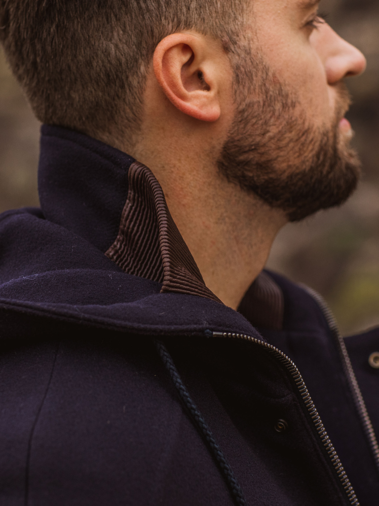 Elasticized accordion-style lamb inserts on the collar and waist combine with feather-soft wool/cashmere to create an unmatched level of comfort