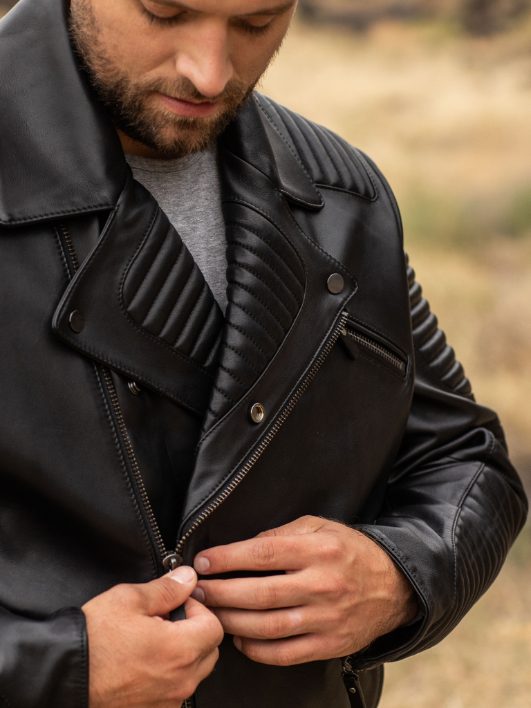 An asymmetrical front placket with the option of zipper and/or power-snap enclosures doubly secures the ride