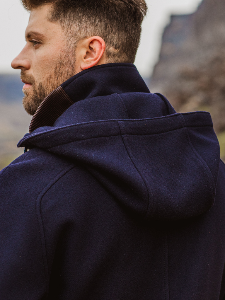 With unparalleled comfort, the double layered wool/cashmere hood envelops one's head and drapes softly over the shoulders during normal wear