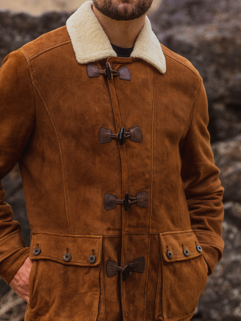 Rich, autumn colored lamb suede is accented by perfectly matching toggles and buttons