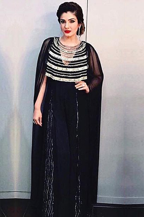 RAVEENA TANDON IN OUR BLACK CAPE SLEEVE JUMPSUIT