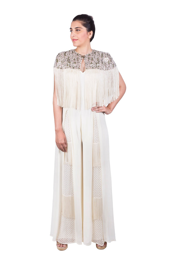 IVORY PANEL JUMPSUIT WITH TASSELED CAPE