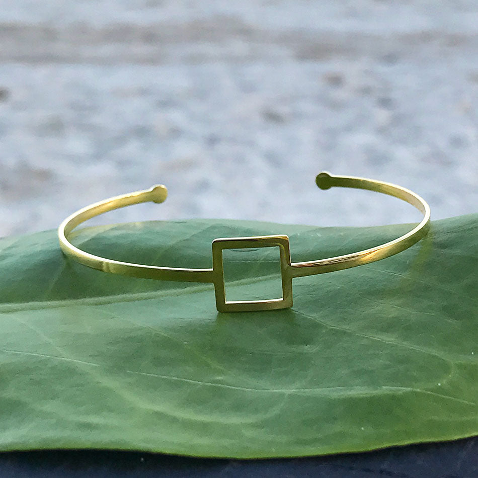 Fair trade gold cuff bracelet handmade by survivors of human trafficking