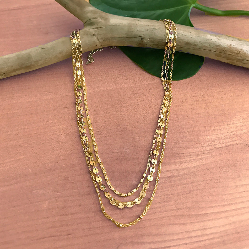 Fair trade brass necklace handmade by survivors of human trafficking.