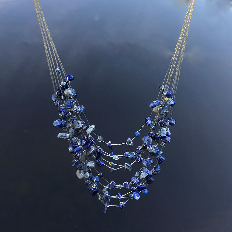 Fair trade necklace handmade by women in Thailand featuring lapis stones.