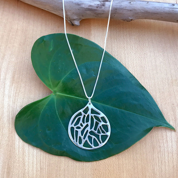Fair trade sterling silver necklace handmade by survivors of human trafficking.