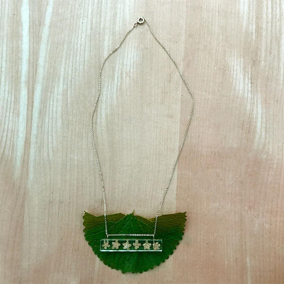 Recycled resin necklace handmade by women in Colombia