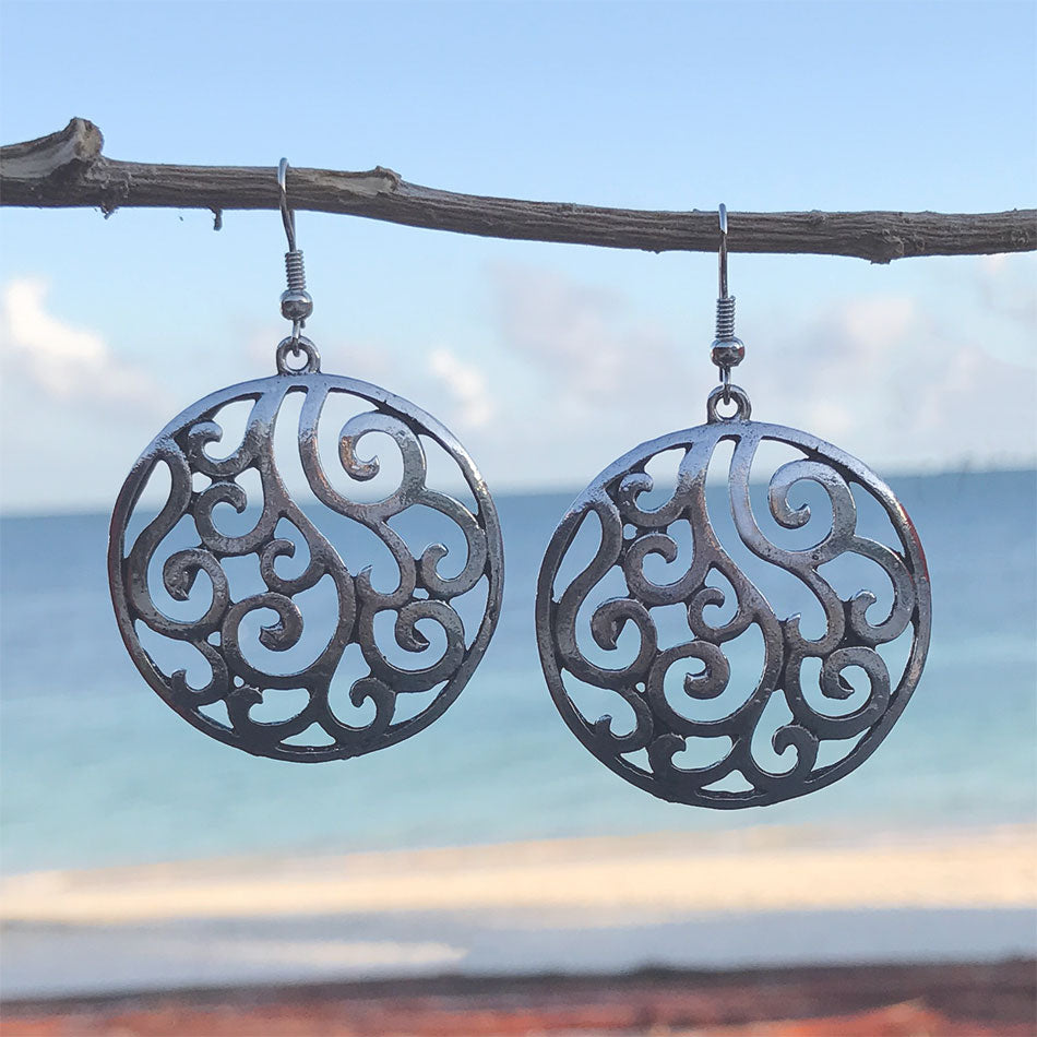 Fair trade silver earrings handmade by survivors of human trafficking