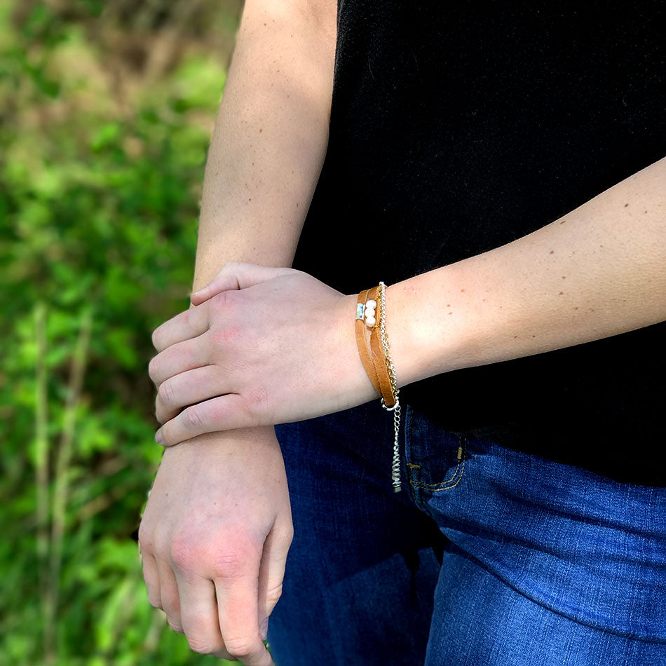 Fair trade leather and pearl bracelet handmade by survivors of human trafficking