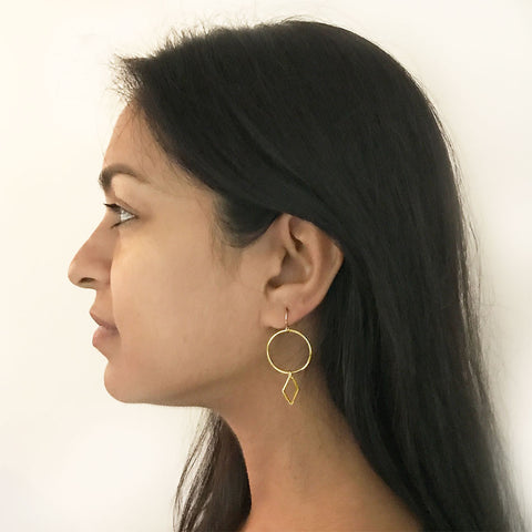 Fair trade brass earrings handmade by survivors of human trafficking