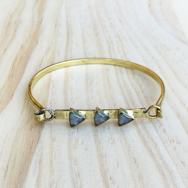 Fair trade brass bracelet with triangle stones.
