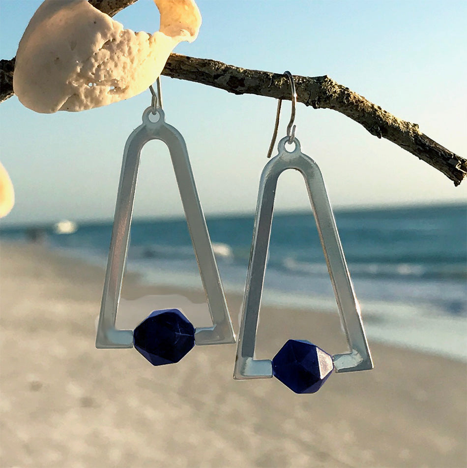 Fair trade silver earrings handmade by survivors of human trafficking.