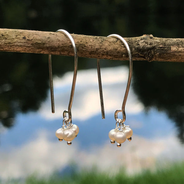 Sterling silver and pearl fair trade earrings.