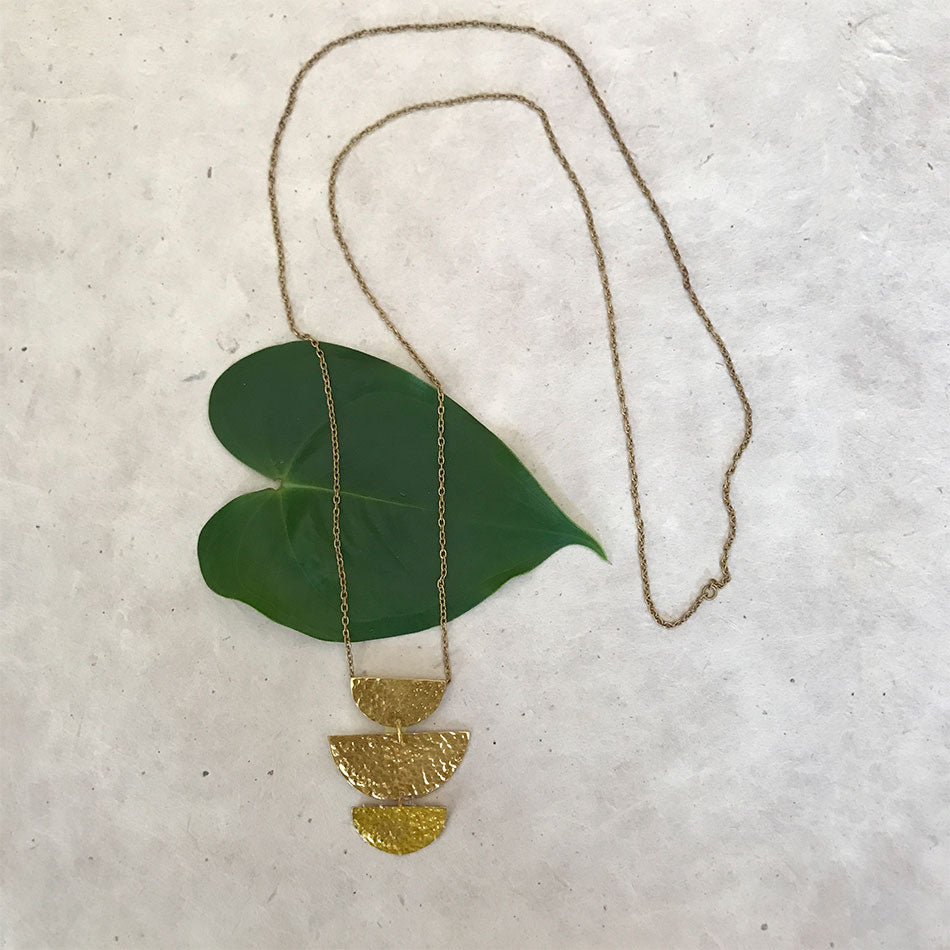 Fair trade long brass necklace handmade by survivors of human trafficking.