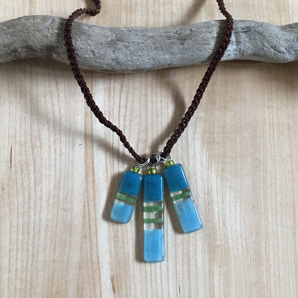 Fused glass necklace handmade and fair trade.